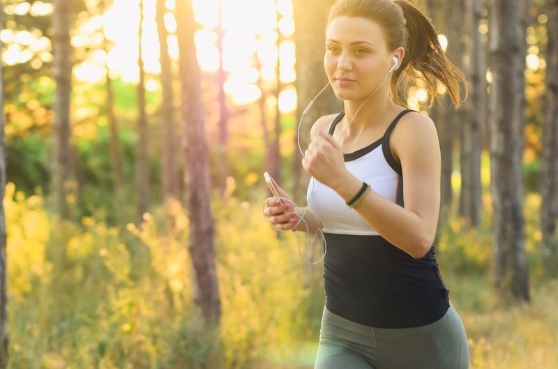 woman exercising while listening to music, natural remedies for anxiety and depression, herbs for anxiety and depression